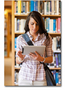 A student using a tablet in her school library